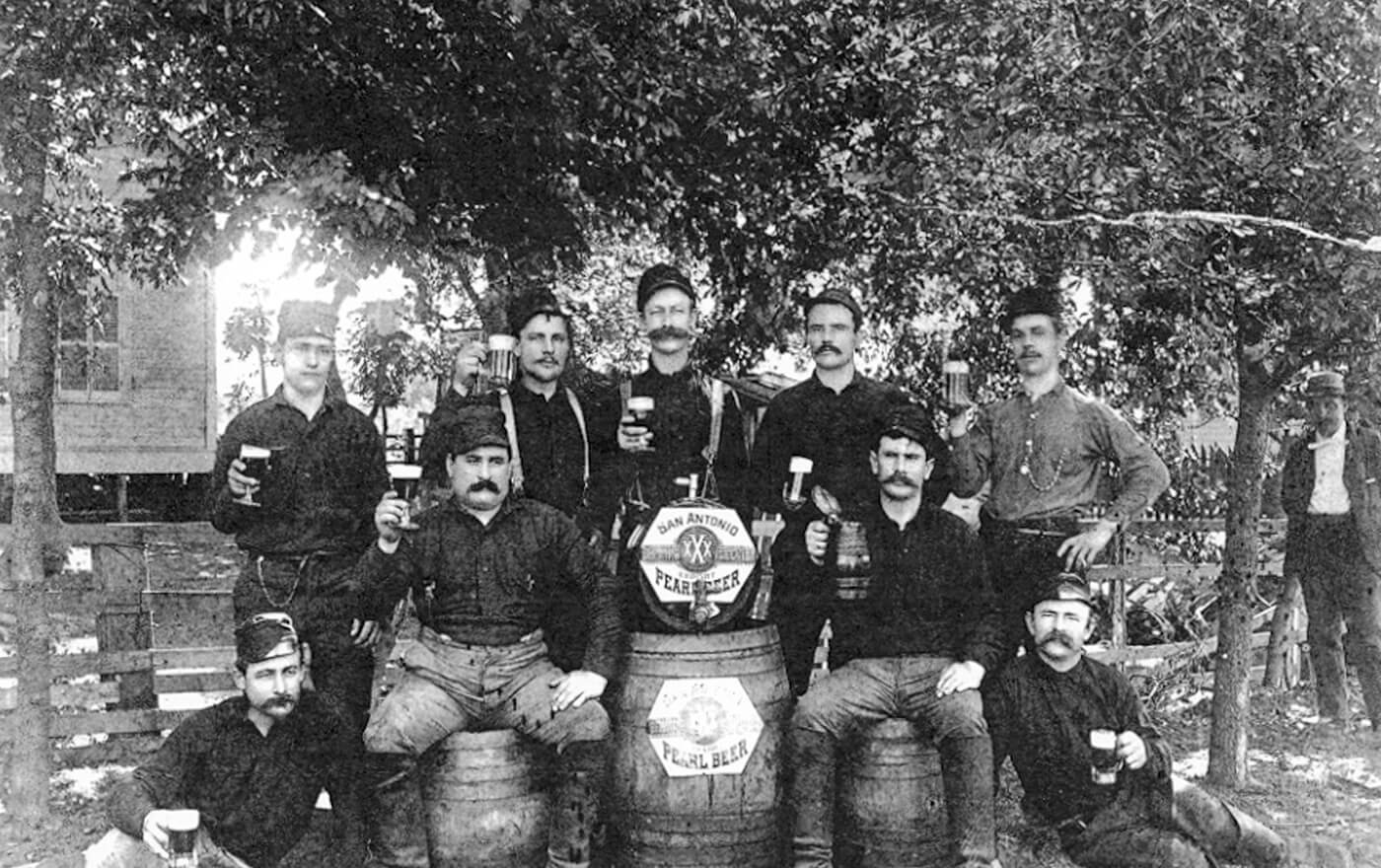 A picture of the group men drinking beer with fin de Siecle mustaches.