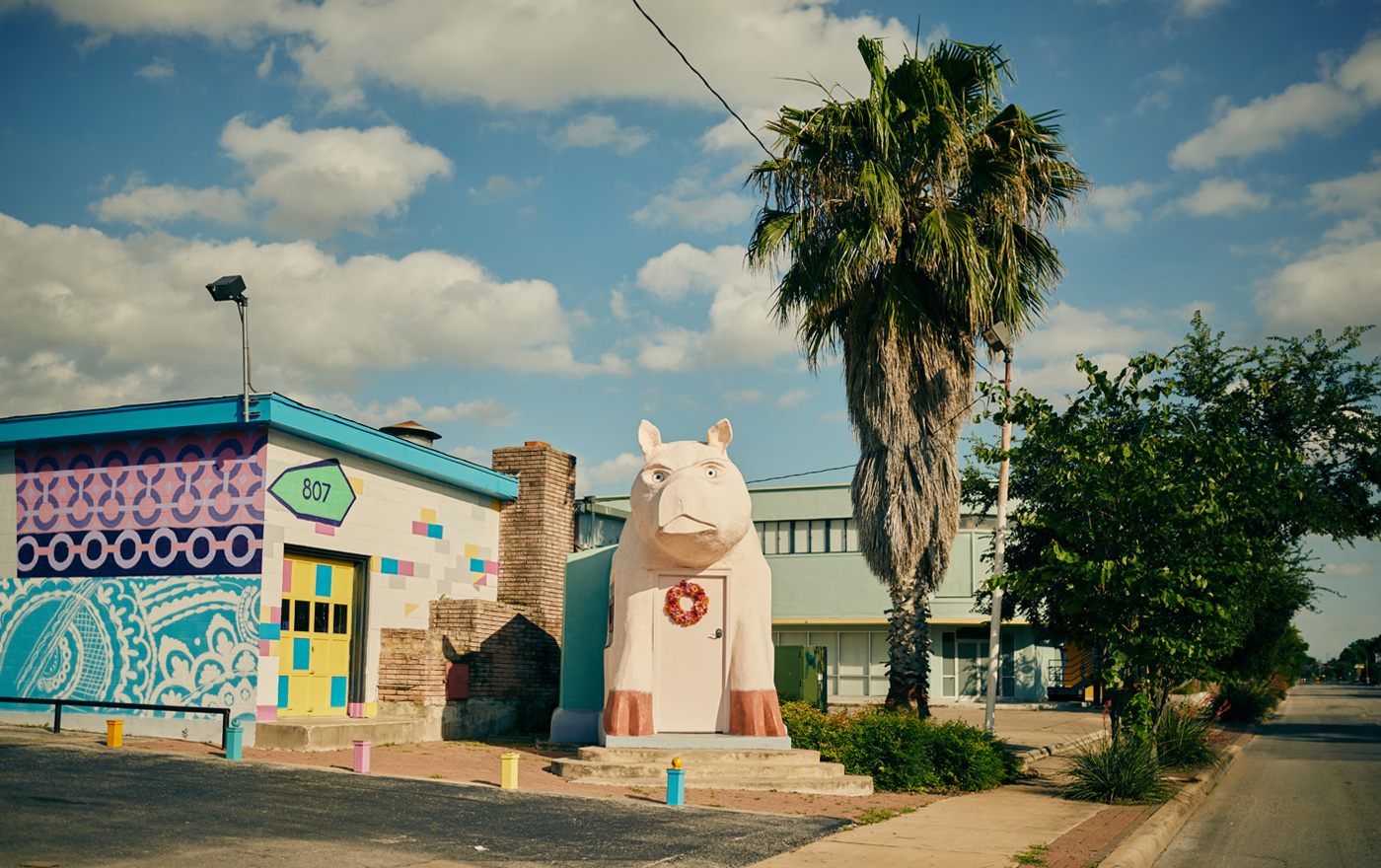 Picture of a colorful building and pig statue located in Southtown