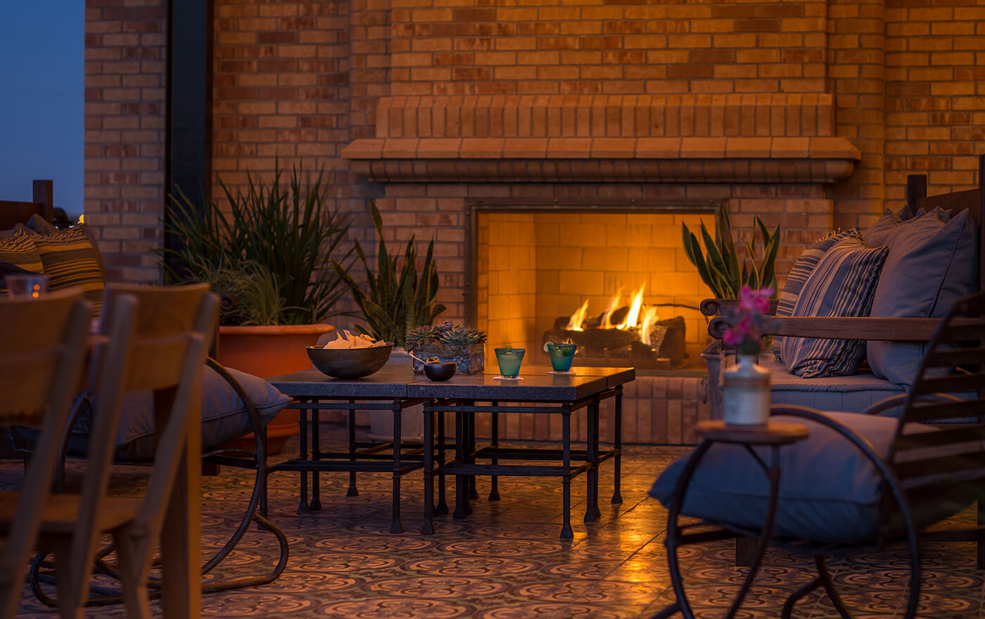 A picture of the terrace of  Hotel Emma's Emma Koehler suite option. Pictured is a close view of the fireplace next to the seating arrangement.