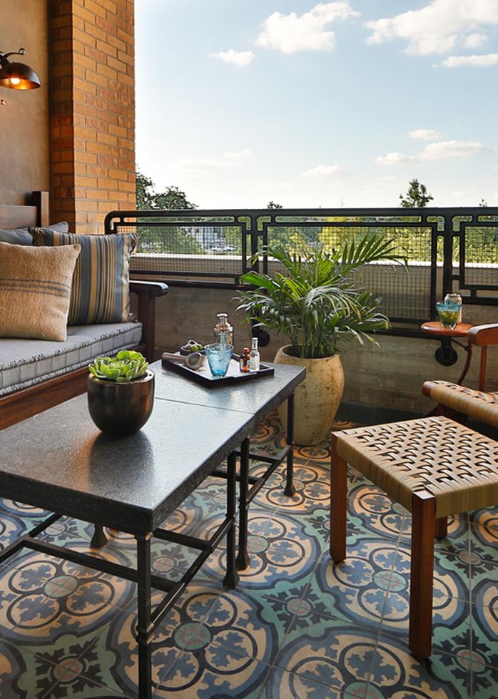 A picture of the terrance of Hotel Emma's Terrace rooms. Pictured is a table with decorations and a view of the city.