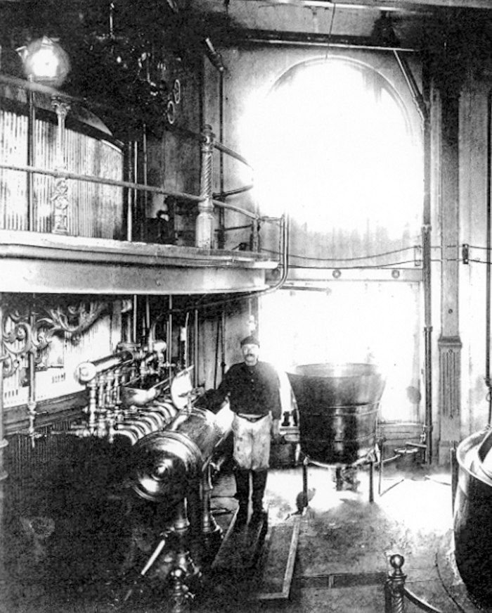 A black and white picture of an employee working at the Pearl Brewery
