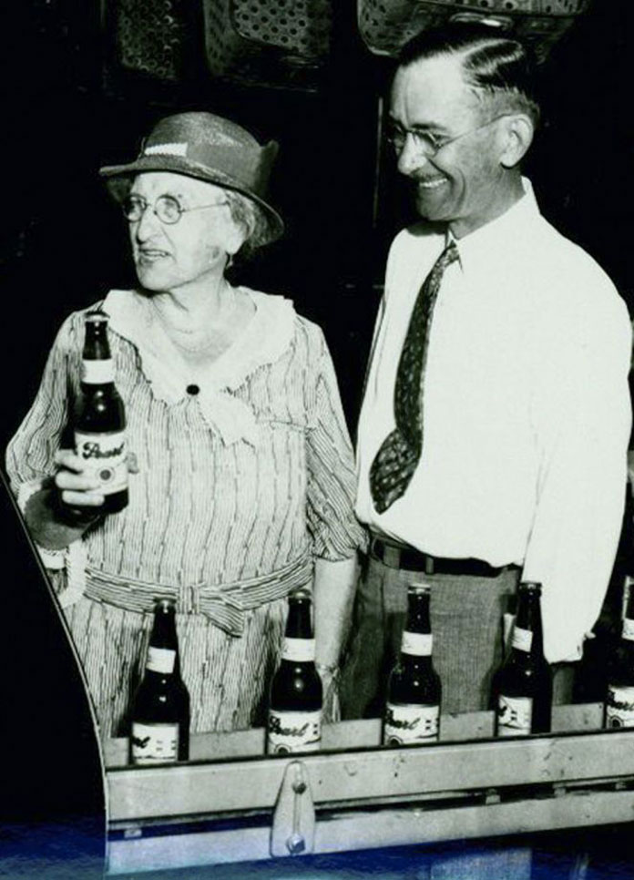 A black and white picture of Emma Koehler, widow of Otto Koehler. Emma Koehler is holding a picture of the Peal's beer.