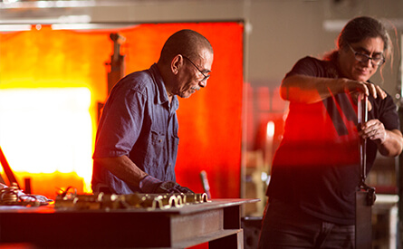 Two blacksmiths working in studio