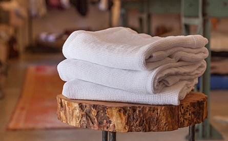 Stack on towels on a stool